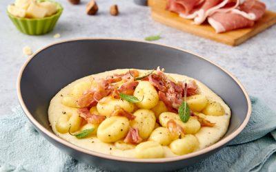 Gnocchi di patate con prosciutto crudo, salvia e fonduta di parmigiano reggiano